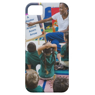 Teacher with preschool students in classroom iPhone 5 cases