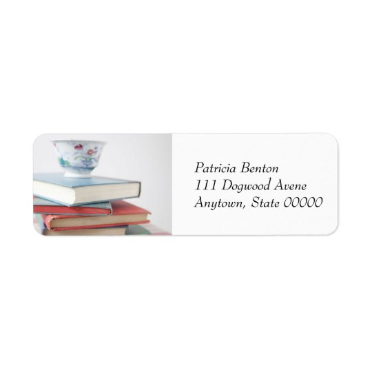 Teacup on book stack address label