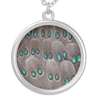 Teal spotted pheasant feather silver plated necklace