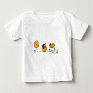 Team of miniature figurines transporting walnut baby T-Shirt