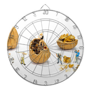 Team of miniature figurines transporting walnut dartboard