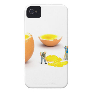 Team of miniature human figurines transporting egg iPhone 4 covers