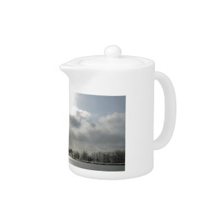 teapot with photo of icy winter landscape