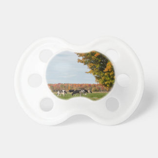 Teat of photo baby of cows with tree pacifier