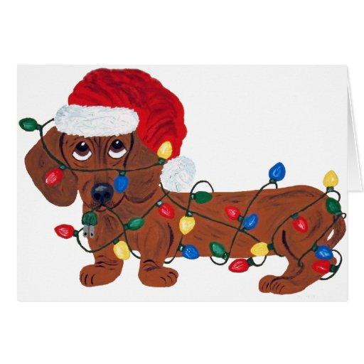 Teckel embrouillé dans des lumières de Noël (rouge Cartes De Vœux
