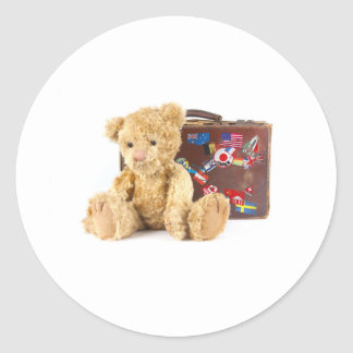 teddy bear and vintage old suitcase with world sti round sticker