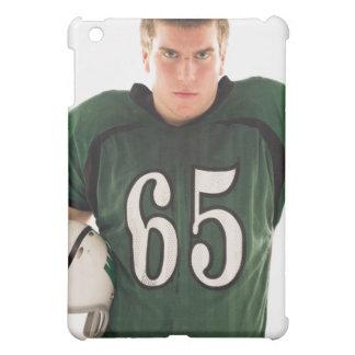 Teen football player holding helmet, portrait case for the iPad mini