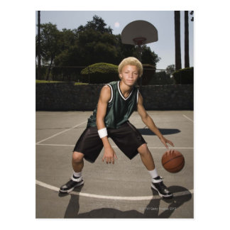 Teenage boy on basketball court postcard
