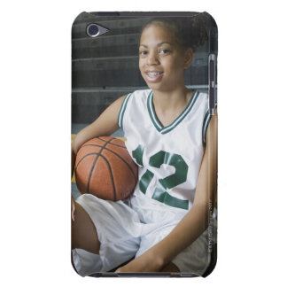 Teenage girl (13-15) wearing basketball uniform, barely there iPod cases