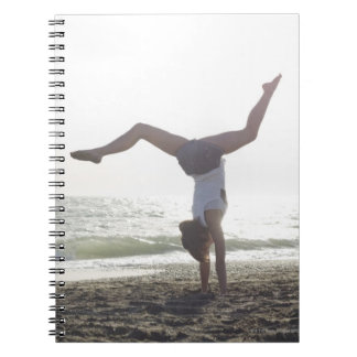 Teenage girl performs gymnastic feat, mom notebook