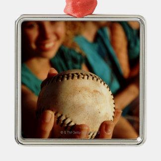 Teenage girls' softball team sitting in dugout metal ornament
