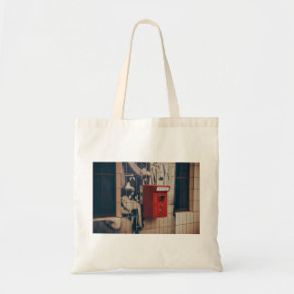 Telephone box on a wall budget tote bag