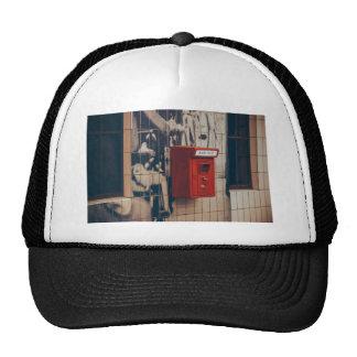 Telephone box on a wall trucker hat
