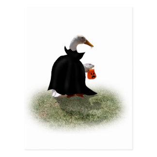 Temps de des bonbons ou un sort pour le canard de carte postale