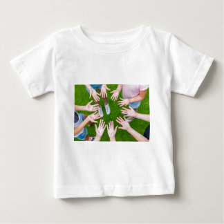 Ten arms of children in circle with palms of hands baby T-Shirt