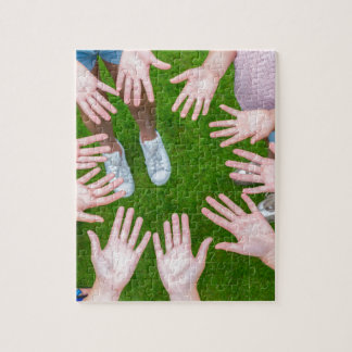 Ten arms of children in circle with palms of hands jigsaw puzzle