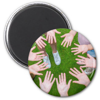Ten arms of children in circle with palms of hands magnet