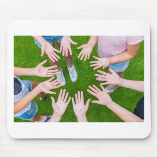 Ten arms of children in circle with palms of hands mouse pad