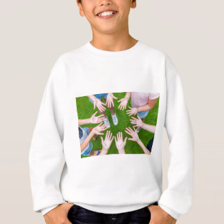 Ten arms of children in circle with palms of hands sweatshirt