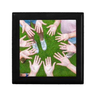 Ten arms of children in circle with palms of hands trinket box