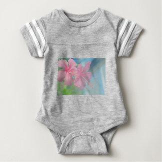 Tender macro shoot of pink hibiscus flowers baby bodysuit