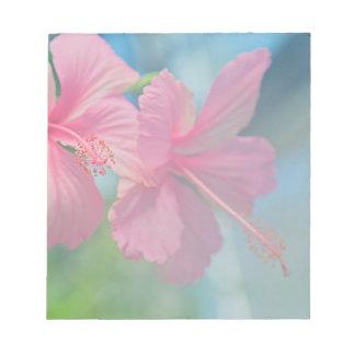 Tender macro shoot of pink hibiscus flowers notepad