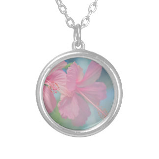 Tender macro shoot of pink hibiscus flowers silver plated necklace