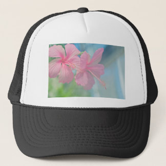 Tender macro shoot of pink hibiscus flowers trucker hat