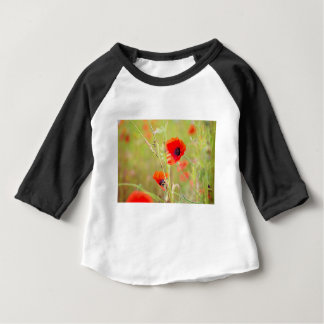Tender shot of red poppies on the field baby T-Shirt
