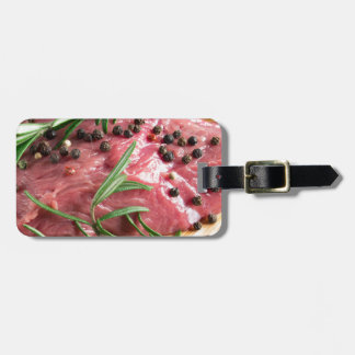 Tenderloin of raw beef with herbs and spices luggage tag