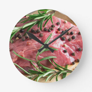 Tenderloin of raw beef with herbs and spices round clock