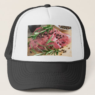 Tenderloin of raw beef with herbs and spices trucker hat
