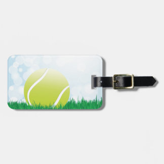 tennis ball on grass luggage tag
