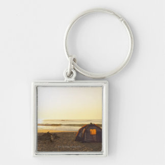 Tent and Burned out Campfire on the Beach. Keychain