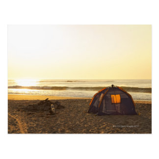 Tent and Burned out Campfire on the Beach. Postcard