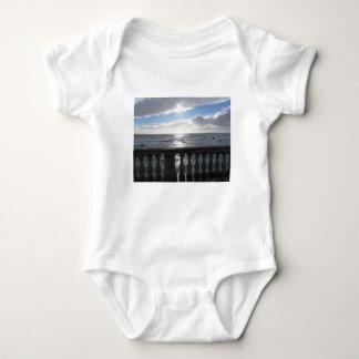 Terrace overlooking the sea baby bodysuit
