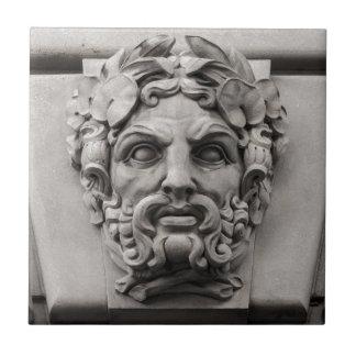Terracotta Stone Faces on Historic Building Tile