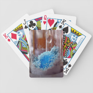 Test tube with blue chemical powder poker deck