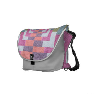 Textile heat in pink and gray commuter bags