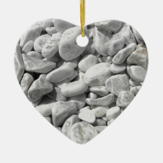 Texture of pebbles from a beach shore ceramic heart ornament