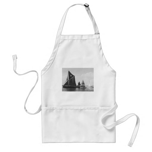 Thames barge race with flotilla of small boats apron