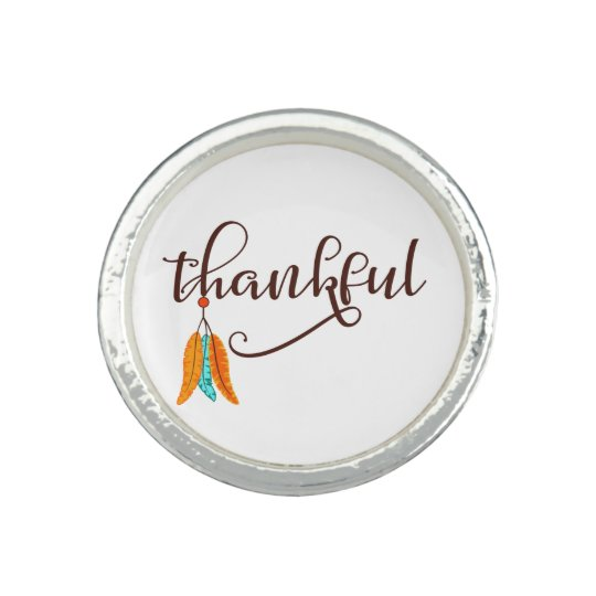 Thankful in fancy font with feathers rings