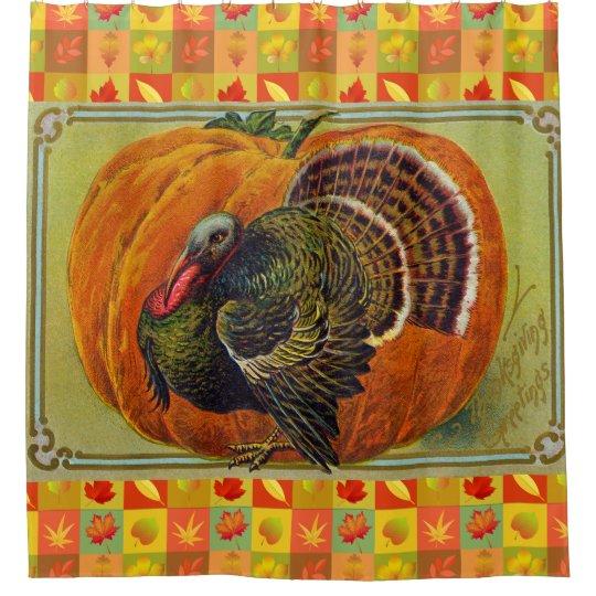 Thanksgiving Turkey in front of a Orange Pumpkin
