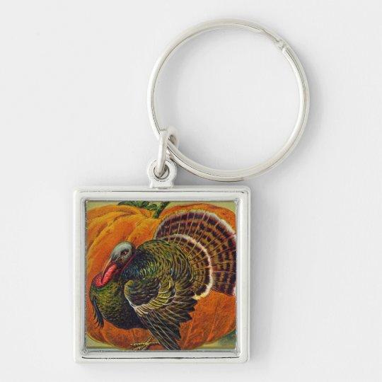 Thanksgiving Turkey in front of a Orange Pumpkin Keychain
