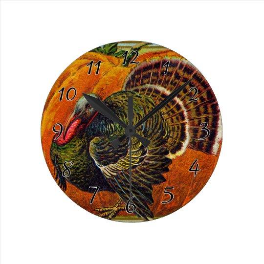 Thanksgiving Turkey in front of a Orange Pumpkin Round Clock