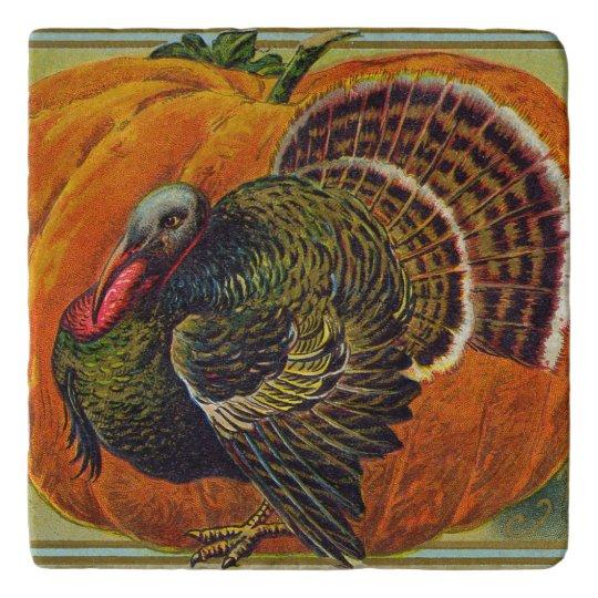 Thanksgiving Turkey in front of a Orange Pumpkin Trivet