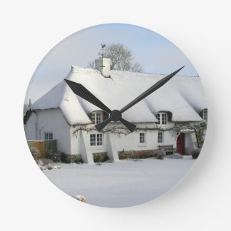 Thatched English Cottage in Snow Round Clock