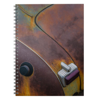 The beauty of texture of an aged vintage car spiral note book