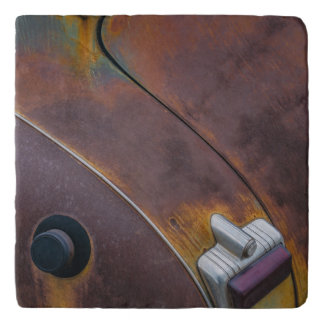 The beauty of texture of an aged vintage car trivet