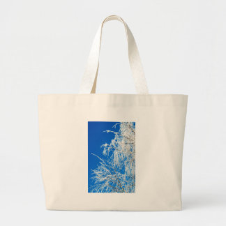 The branches of the tree during the winter large tote bag